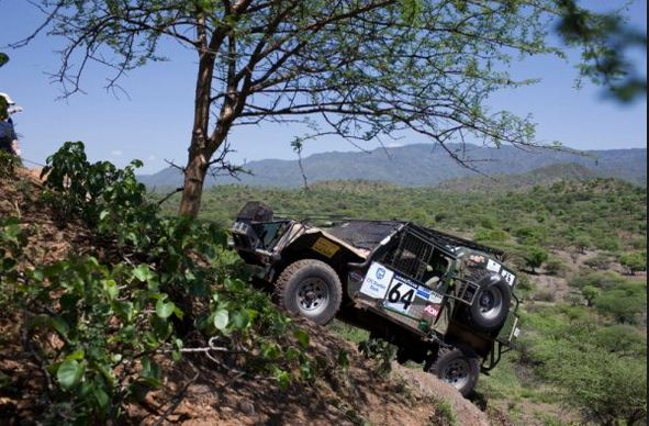 A driver charges uphill during the Rhino Charge